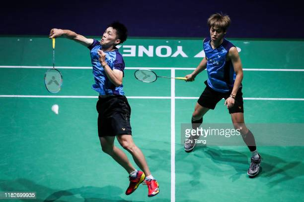 Lee JheHuei and Yang PoHsuan of Chinese Taipei compete in the Men's Doubles first round match against Wang ChiLin and Lee Yang of Chinese Taipei on...