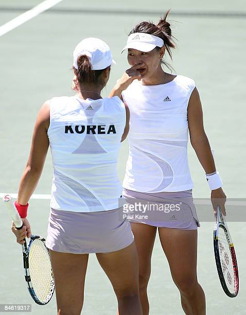 Lee JinA and Chang Kyung Mi of Korea talk tactics during the doubles match in the first round Fed Cup match between Australia and Korea at The State...