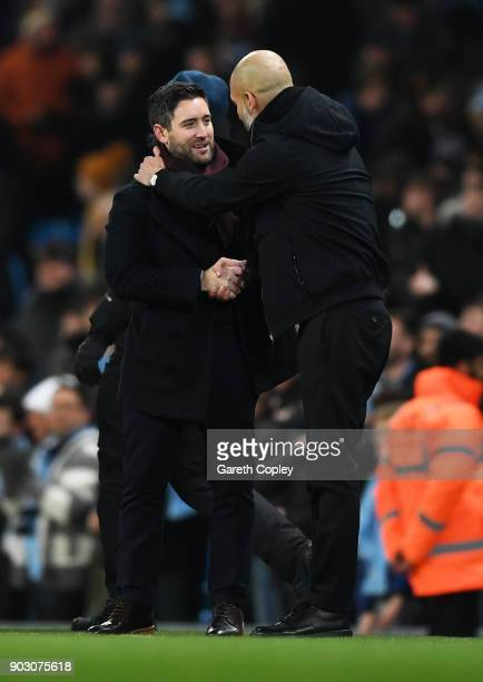 Lee Johnson manager of Bristol City and Josep Guardiola Manager of Manchester City shake hands after the Carabao Cup SemiFinal First Leg match...