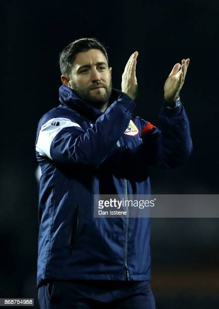 Lee Johnson manager of Bristol City applauds the fans after the Sky Bet Championship match between Fulham and Bristol City at Craven Cottage on...