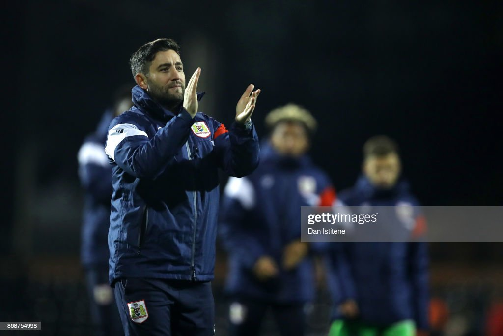 Lee Johnson, manager of Bristol City applauds the fans after the Sky Bet Championship match between Fulham and Bristol City at Craven Cottage on October 31, 2017 in London, England.