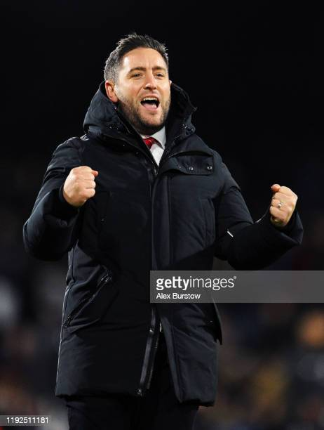 Lee Johnson, Manager of Bristol City celebrates to the fans at full-time after his team's victory in the Sky Bet Championship match between Fulham...