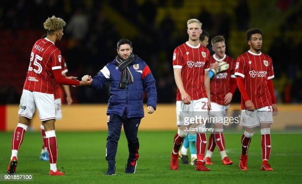 Lee Johnson manager of Bristol City celebrates with Lloyd Kelly of Bristol City after The Emirates FA Cup Third Round match between Watford and...