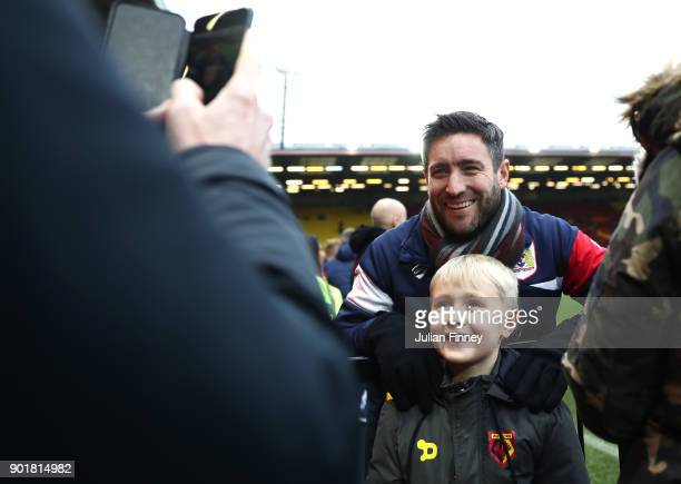 Lee Johnson manager of Bristol City poses with a Watford fan prior to The Emirates FA Cup Third Round match between Watford and Bristol City at...