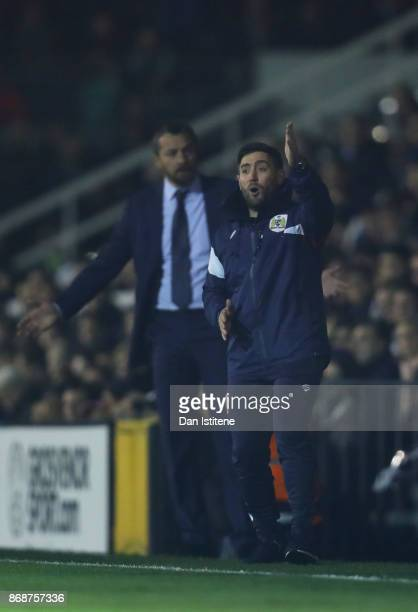 Lee Johnson manager of Bristol City reacts on the touchline next to Slavisa Jokanovic manager of Fulham during the Sky Bet Championship match between...
