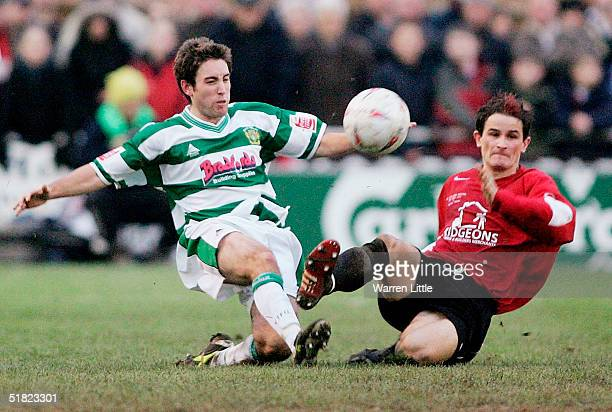 Lee Johnson of Yeovil is tackled by Adrian Cambridge of Histon during the FA Cup second round match between Histon FC and Yeovil Town FC at the...