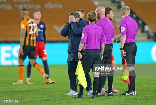 Lee Johnson, Sunderland head coach holds his head in hands after he talks to the officials on the final whistle during the Sky Bet League One match...