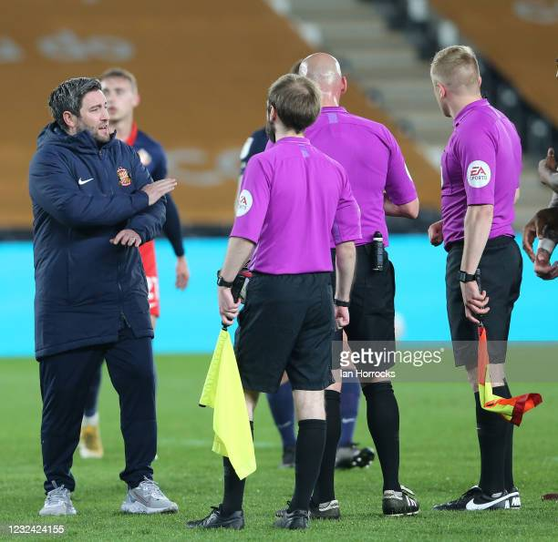 Lee Johnson, Sunderland head coach talks to the officials on the final whistle during the Sky Bet League One match between Hull City and Sunderland...