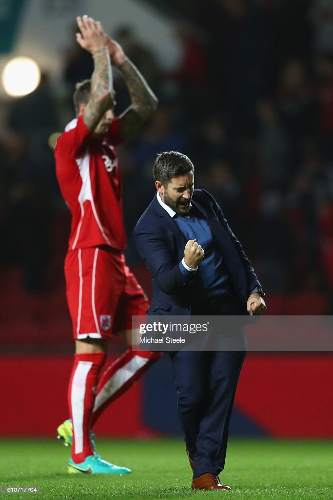 Lee Johnson the manager of Bristol City celebrates his sides 1-0 victory during the Sky Bet Championship match between Bristol City and Leeds United at Ashton Gate on September 27, 2016 in Bristol, England.