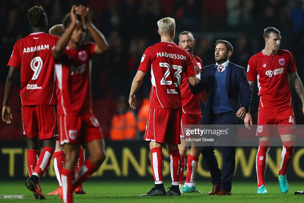 Lee Johnson the manager of Bristol City congratulates his players after his sides 1-0 victory during the Sky Bet Championship match between Bristol City and Leeds United at Ashton Gate on September 27, 2016 in Bristol, England.