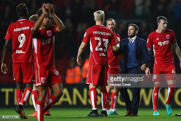 Lee Johnson the manager of Bristol City congratulates his players after his sides 10 victory during the Sky Bet Championship match between Bristol...