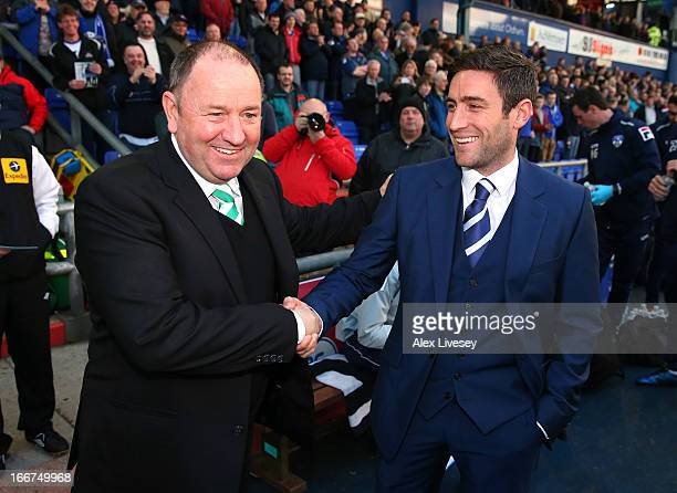 Lee Johnson the manager of Oldham Athletic shakes hands with his father Gary Johnson the manager of Yeovil Town prior to the npower League One match...