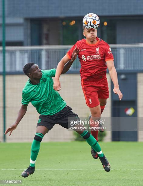 Lee Jonas of Liverpool and Matthew Lusakueno of Stoke City in action during the U18 Premier League game at AXA Training Centre on August 14, 2021 in...