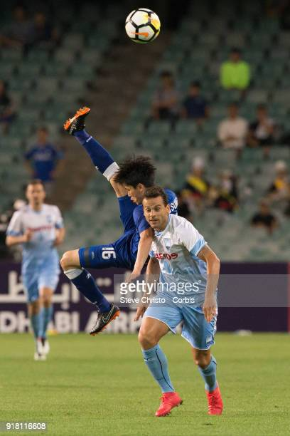 Lee Jong Sung of the Bluewings leaps over Deyvison Rogerio Da Silva of Sydney FC during the AFC Asian Champions League match between Sydney FC and Suwon Bluewings at Allianz Stadium on February 14, 2018 in Sydney, Australia.