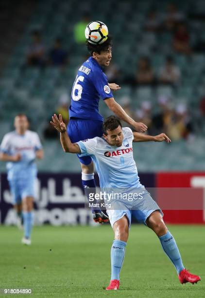 Lee JongSung of the Bluewings jumps over Bobo of Sydney FC for a header during the AFC Asian Champions League match between Sydney FC and Suwon...