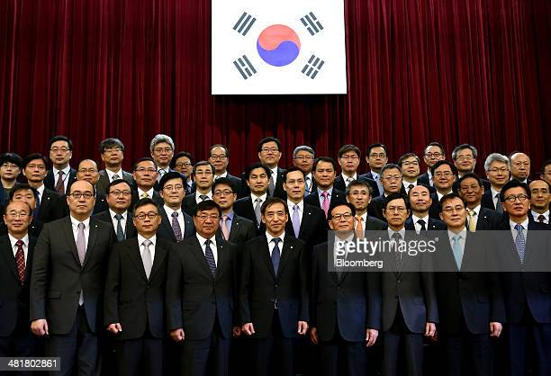 Lee Ju Yeol governor of the Bank of Korea front row center poses for a photograph with members of his staff following his inauguration ceremony at...