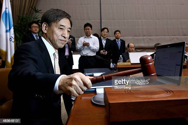 Lee Ju Yeol governor of the Bank of Korea hits a gavel as he starts a monetary policy meeting at the central bank's headquarters in Seoul South Korea...