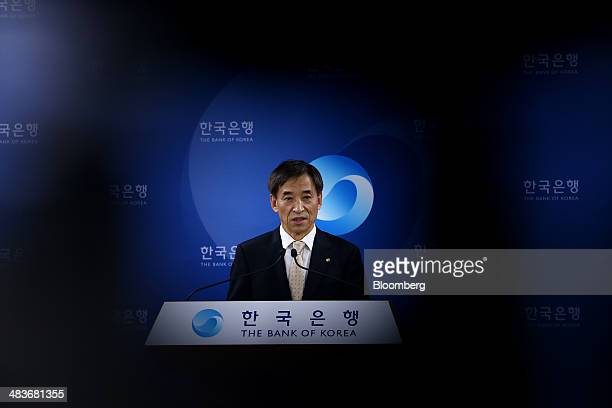 Lee Ju Yeol governor of the Bank of Korea is seen through a gap in a television camera during a news conference following a monetary policy meeting...