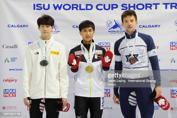 Lee June Seo of Korea Kazuki Yoshinaga and Vladislav Bykanov of Israel pose with their medals after placing in the 1500m men's final during the ISU...