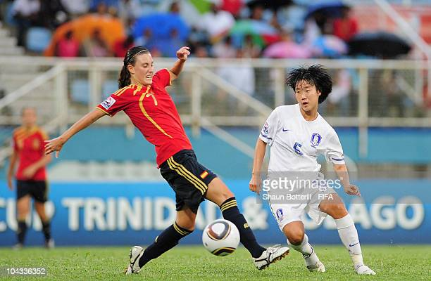 Lee Jungeun of South Korea is challenged by Gema Gili of Spain during the FIFA U17 Women's World Cup Semi Final match between South Korea and Spain...