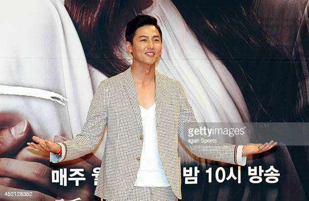 Lee JungJin poses for photographs during the SBS drama 'Temptation' press conference at SBS broadcasting center on July 10 2014 in Seoul South Korea
