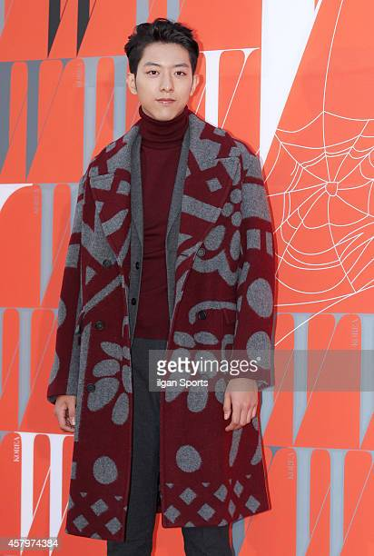 Lee JungShin of CNBLUE poses for photographs during the W Korea campaign Love Your W party at Fradia on October 23 2014 in Seoul South Korea