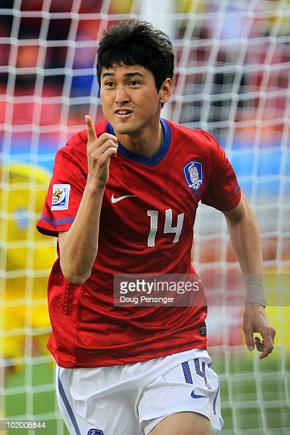 Lee JungSoo of South Korea celebrates scoring the opening goal during the 2010 FIFA World Cup South Africa Group B match between South Korea and...