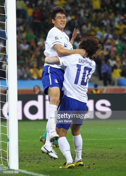 Lee JungSoo of South Korea celebrates with team mate Park ChuYoung after scoring the equalising goal during the 2010 FIFA World Cup South Africa...
