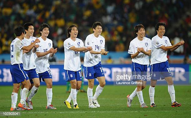 Lee JungSoo of South Korea celebrates with team mates after scoring the equalising goal during the 2010 FIFA World Cup South Africa Group B match...