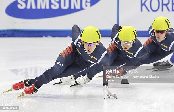 Lee JungSu Kwal WoonGy and Sin DaWoon of South Korea compete in the Men 3000M Final A during the ISU World Cup Short Track Speed Skating 2014/15...
