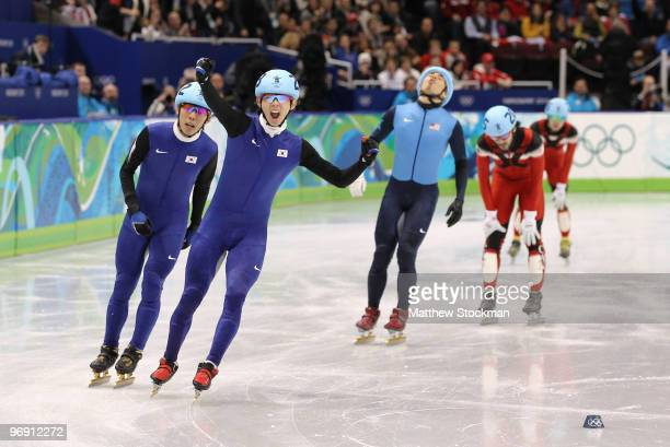 Lee JungSu of South Korea celebrates winning the gold medal from silver medalist Lee HoSuk of South Korea and bronze medalist Apolo Anton Ohno of the...