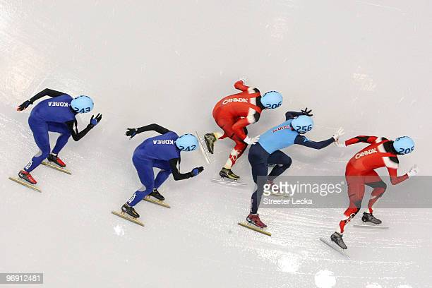 Lee Jung-Su of South Korea, Lee Ho-Suk of South Korea, Francois Hamelin of Canada, Apolo Anton Ohno of the United States and Charles Hamelin of...