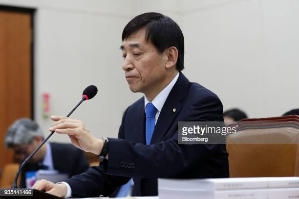 Lee Juyeol governor of the Bank of Korea adjusts a microphone during a parliamentary hearing for his reappointment at the National Assembly in Seoul...