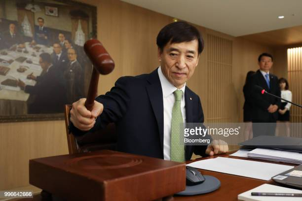 Lee Juyeol governor of the Bank of Korea hits a gavel as he starts a monetary policy meeting in Seoul South Korea on Thursday July 12 2018 BOK left...