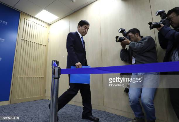 Lee Juyeol governor of the Bank of Korea leaves a news conference in Seoul South Korea on Thursday Nov 30 2017 BOK raised its benchmark interest rate...