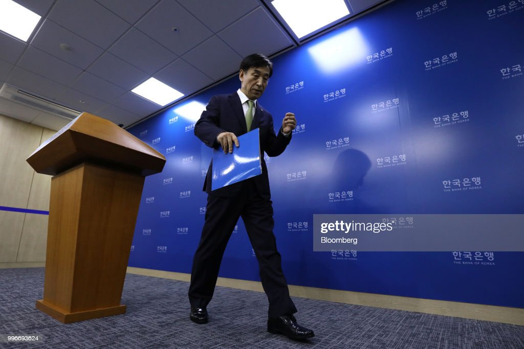 Lee Ju-yeol, governor of the Bank of Korea (BOK), leaves a news conference in Seoul, South Korea, on Thursday, July 12, 2018. The central bank left its key interest rate unchanged amid a sharp rise in global trade tensions and slowing jobs growth in Asia's fourth-largest economy. Photographer: SeongJoon Cho/Bloomberg via Getty Images