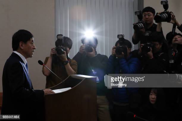 Lee Juyeol governor of the Bank of Korea left speaks as photographers take photographs during a parliamentary hearing for his reappointment at the...