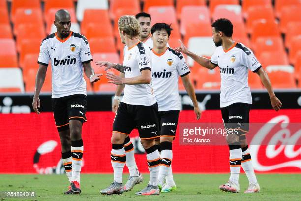 Lee Kangin Lee of Valencia CF celebrates with his team mates after scoring his team's second goal during the Liga match between Valencia CF and Real...