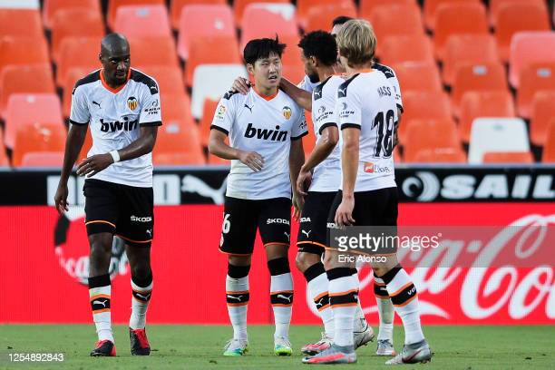 Lee Kang-in Lee of Valencia CF celebrates with his team mates after scoring his team's second goal during the Liga match between Valencia CF and Real...