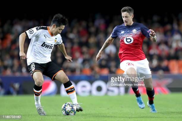 Lee Kang-In of Valencia battles for possession with Boubakary Soumare of Lille during the UEFA Champions League group H match between Valencia CF and...