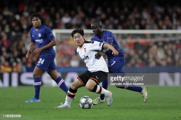 Lee Kang-In of Valencia CF competes for the ball with N'Golo Kante of Chelsea during the UEFA Champions League group H match between Valencia CF and...