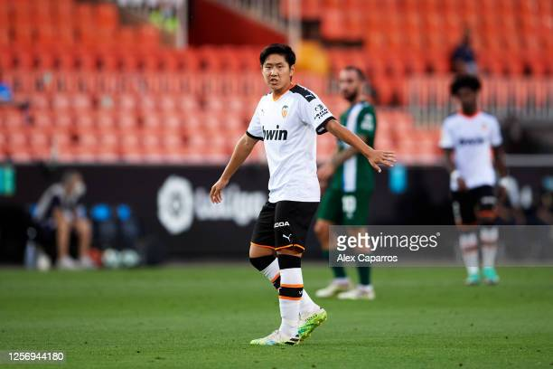 Lee KangIn of Valencia CF gives instructions during the Liga match between Valencia CF and RCD Espanyol at Estadio Mestalla on July 16 2020 in...