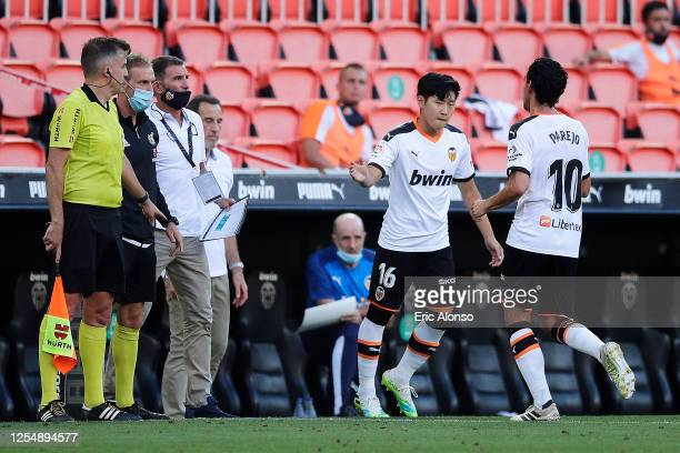 Lee Kang-in of Valencia CF replaces Oscar Plano of Real Valladolid CF during the Liga match between Valencia CF and Real Valladolid CF at Estadio...