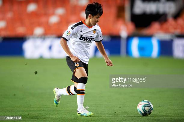 Lee KangIn of Valencia CF runs with the ball during the Liga match between Valencia CF and RCD Espanyol at Estadio Mestalla on July 16 2020 in...