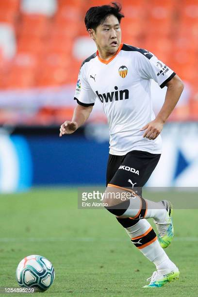 Lee Kang-in of Valencia CF runsw ith the ball during the Liga match between Valencia CF and Real Valladolid CF at Estadio Mestalla on July 07, 2020...