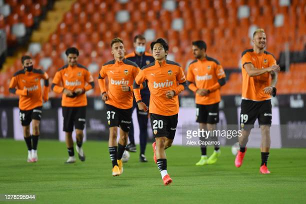 Lee Kang-In of Valencia CF warms up prior to the La Liga Santander match between Valencia CF and Real Betis at Estadio Mestalla on October 03, 2020...