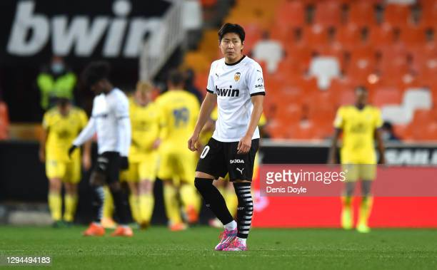 Lee Kang-In of Valencia reacts to Cadiz CF scoring their first goal during the La Liga Santander match between Valencia CF and Cadiz CF at Estadio...