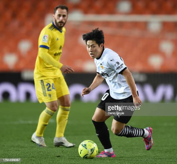 Lee Kang-In of Valencia runs with the ball during the La Liga Santander match between Valencia CF and Cadiz CF at Estadio Mestalla on January 04,...