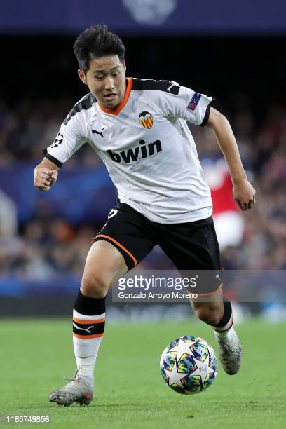 Lee Kang-In of Valencia runs with the ball during the UEFA Champions League group H match between Valencia CF and Lille OSC at Estadio Mestalla on...