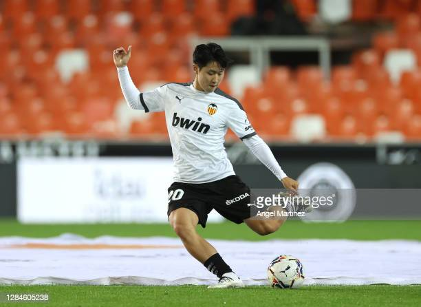Lee Kang-In of Valencia warms up prior to the La Liga Santander match between Valencia CF and Real Madrid at Estadio Mestalla on November 08, 2020 in...